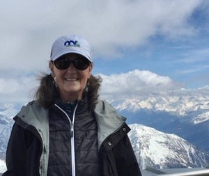 Anne, a Clinical Trials Search & Support patient, on a mountain top